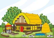 Maison de village avec la source et les planches de puits de foin illustration stock