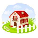 Maison de vintage sur une pelouse d'été Photo stock