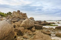 Old customs house at beach of Cleder, Brittany, France. Maison des Douaniers, ancient customs house in the rocks of Brittany beach at Cleder Royalty Free Stock Photos