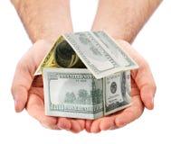 Maison du dollar sur les mains Image libre de droits