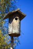 Maison en bois d'emboîtement Photo stock