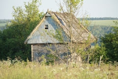 Maison en bois dans la forêt Images stock