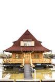 Maison en bois sur la rivière Photos stock