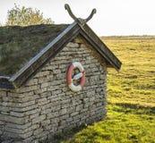 Maison en pierre avec la balise de vie Photographie stock libre de droits