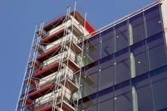 Maison en verre moderne neuve vide W Photo libre de droits