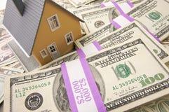 Maison et argent Image stock