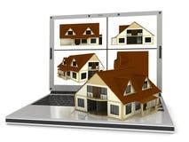 Maison et ordinateur portatif Images stock