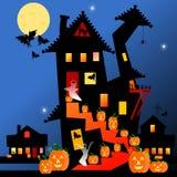 Maison et potirons de Halloween Photo libre de droits