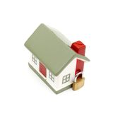 Maison miniature avec le blocage Image stock