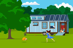 Maison minuscule autonome avec les panneaux solaires sur la nature illustration libre de droits
