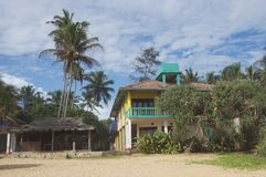 Maison multicolore à la plage Photographie stock libre de droits