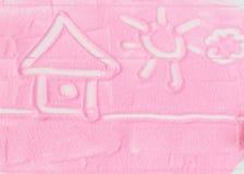Maison peinte du sable décoratif sur une table en bois Images libres de droits