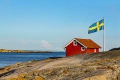 Maison rouge en Suède photographie stock