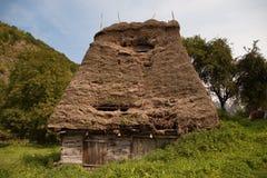 Maison traditionnelle en montagnes Image libre de droits