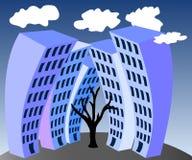 Maisons à plusiers étages et un arbre Photo libre de droits