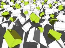 Maisons écologiques vertes se tenant d'autres Image stock