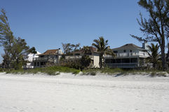 Maisons avant de plage Photographie stock libre de droits