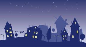 Maisons de dessin animé au nigth Images libres de droits