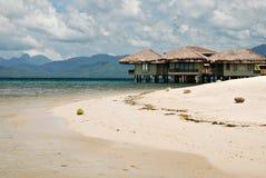 Maisons de plage sur l'eau Photographie stock