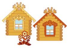 Maisons en bois peintes sur un fond blanc Photographie stock