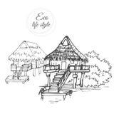 Maisons en bois sur l'eau avec un toit couvert de chaume dans le style d'un croquis Images stock