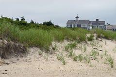 Maisons et dunes de morue de cap Image libre de droits