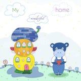 Maisons et hippopotame mignons colorés de conte de fées dans le style de bande dessinée Terre magique Illustration tirée par la m Images stock