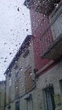 Maisons pluvieuses Image stock