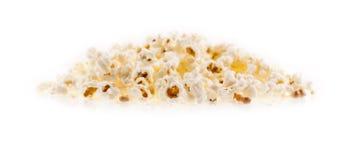 Maissaatgut und Popcorn auf dem weißen Hintergrund Stockfotografie