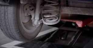 maitainance traseiro velho do amortecedor Fotografia de Stock