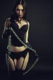 Maitresse in zwarte Royalty-vrije Stock Afbeeldingen