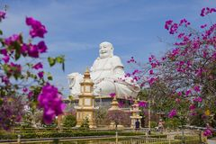 Maitreya Buddha statue located in the famous Vinh Trang pagoda in My Tho city, Tien Giang province, Vietnam Stock Image