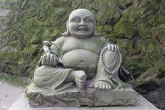 Maitreya buddha stone statue Stock Photo