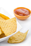 Maize chips in white bowl and salsa sauce Royalty Free Stock Image