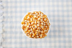 Maize corn. Top view of maize corn on the checker mat Stock Photography