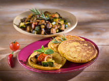 Maize flapjack. With ratatouille over dish Stock Images