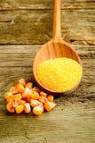 Maize  flour over spoon Stock Photos