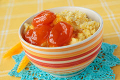 Maize porridge with apricot jam Stock Photo