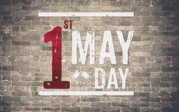 1 Maj dag (internationell arbets- dag) på tegelstenväggen, feriebegrepp Royaltyfri Bild