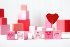 Maj tema med rosa kvarter Royaltyfria Foton