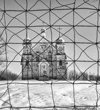 Majestic abandoned church behind wire fence Royalty Free Stock Photography