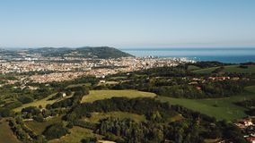 Majestic aerial background panorama of green Mediterranean hills, sea bay horizon and little peaceful town Pesaro Italy. Wonderful cinematic scenery of small stock video footage