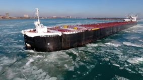 Majestic aerial 4k drone view on large container freight cargo ship vessel tanker sailing in ice glacier river seascape stock video footage