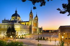 La Almudena Cathedral at Sunset, Madrid, Spain. The majestic Almudena cathedral and the Royal Palace square taken just before the night Royalty Free Stock Image