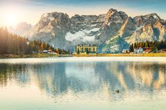 Majestic alpine lake in Dolomites mountains, Misurina lake, Italy, Europe. Amazing sunrise and famous alpine Misurina lake with high Sorapis mountains group in Stock Photos
