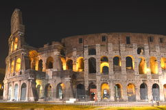 Majestic ancient Colosseum by night in Rome, Italy Stock Images