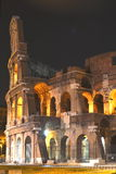 Majestic ancient Colosseum by night in Rome, Italy Royalty Free Stock Image