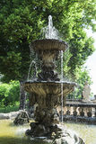 Majestic antique stone fountain in the courtyard of ancient castle Stock Photo
