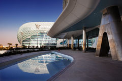 This is a majestic architectural masterpiece. By any standards. The grid shell of the Yas Hotel has become an iconic symbol of Abu Dhabi's Grand Prix Stock Photo
