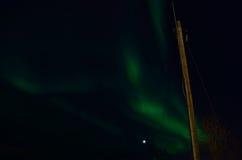Majestic aurora borealis dancing around full moon Royalty Free Stock Images